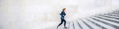 Jogger runs up the stairs.